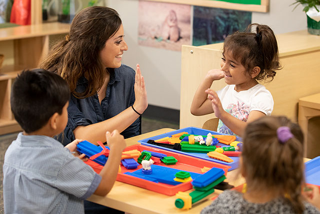 UNT Student Teacher working with young children at the Child Development Lab