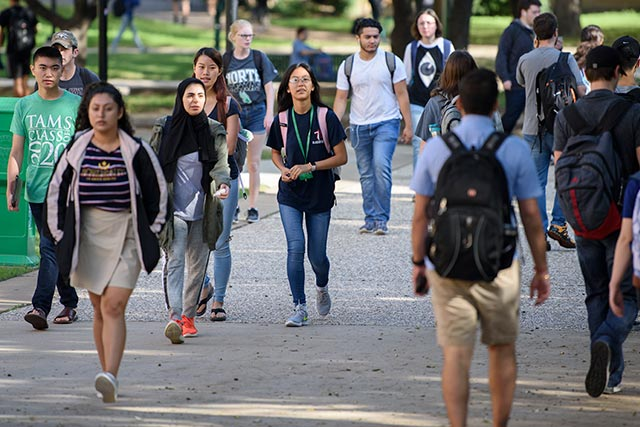 Students walking near the Life Sciences building at UNT.