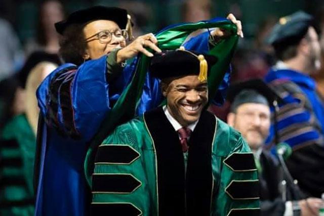 A UNT student receives his Ph.D. award