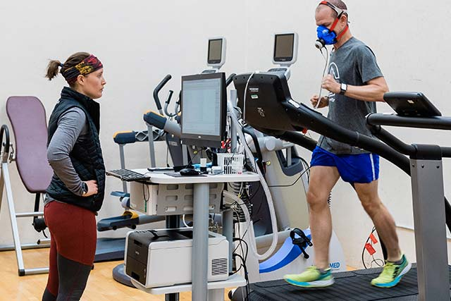 A faculty member runs on a treadmill while being obeserved