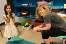 Dee Ray with a young girl in a play room at the Center for Play Therapy