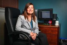 Assistant professor Lauren Eutsler sits at her desk in Matthews Hall on the UNT campus.