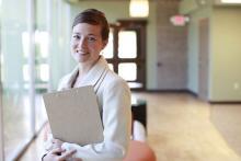 UNT Assistant Professor Dr. Lauren Eutsler stands in a hallway
