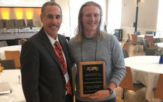 Andrew Colombo-Dougovito receives award