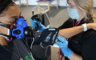 A student's heart rate, blood pressure and oxygen is evaluated following exercise.