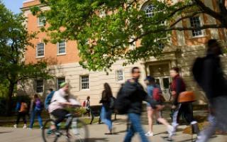 Students walking past Matthews Hall