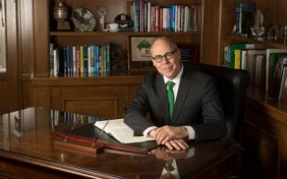 UNT President Neal Smatresk sits at his desk in his office.