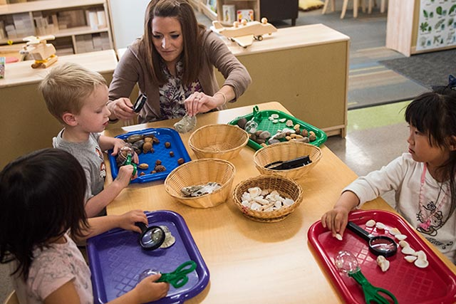 A teacher works with student in the UNT Child Development Lab
